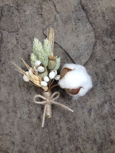 Custom boutonniere, cotton boll with blond wheat, phalaris, poppy pods and tallow berries wrapped in twine