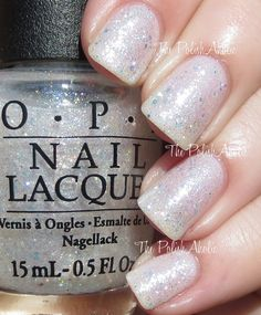 """OPI's """"Make Light over the Situation"""" from its 2015 """"Soft Shades""""Collection. Pretty, sparkly glitter topper full of iridescent glitter. Here, over beautiful, light """"Act Your Beige""""."""