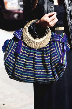 We are digging the pretty pattern on Jessica Baraton's purse, and it was made in Belize — extra cool.     Photographed by Jasmine Gregory