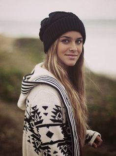 Simple winter fashion style with knitted sweater and woolen hat