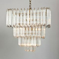A Four Tiered Square Shaped Brass Framed Glass Chandelier 1970s