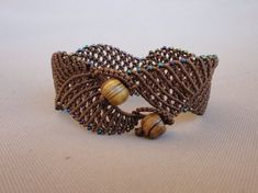 Gentle Wave - macrame bracelet with rainbow seed beads Macrame wide bracelet – The Gentle Wave. Waves can be very instructive. Macrame Necklace, Macrame Jewelry, Macrame Bracelets, Handmade Bracelets, Handmade Jewelry, Unique Jewelry, Diy Rings, Bracelet Crafts, Macrame Tutorial