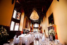 The gallery with ivory damask linens & silver candelabras with white.ivory floral