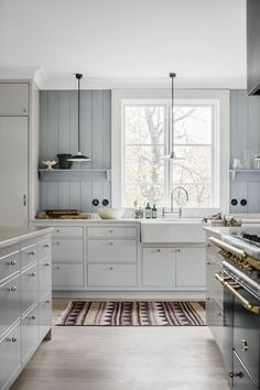 Kitchen with blue walls in A Swedish Family Home in a Former Museum