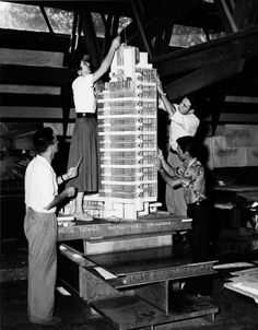 frank lloyd wright, h. c. price company tower, bartlesville, oklahoma, apprentices working on the model in the taliesin drafting room, spring green, wisconsin, 1952 @ artblart