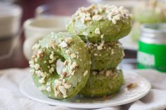 These baked doughnuts get a burst of color from matcha green tea, and are topped with a sweet almond glaze and a sprinkling of crunchy almonds. Donut Recipes, Tea Recipes, Baking Recipes, Recipies, Baked Doughnuts, Vegan Doughnuts, Mini Donuts, Buzzfeed Food, Food Is Fuel