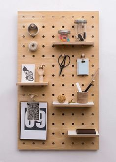 Tiny plywood pegboard is a great way to organize.