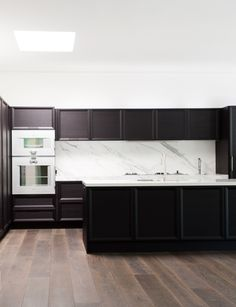 Classic dark cabinets + marble backsplash by Rogerseller