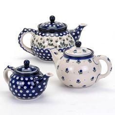 Set of three blue floral tea pots