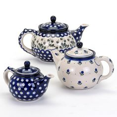 Set of three blue floral tea pots