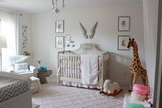 Elegant and Airy Baby Girl Nursery - love the angel wings over the crib!