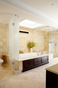 LOVE the skylight over the tub!  Imagine soaking while staring at the sky!