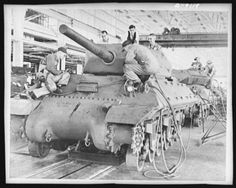 WWII, Grand Blanc, Michigan - An tank destroyer (official name - Gun Motor Carriage, in mass production at the General Motors' Tank Arsenal in March This vehicle is in the final stage of assembly. Armored Vehicles, Military Vehicles, M10 Tank Destroyer, M10 Wolverine, Self Propelled Artillery, Tank Armor, Ww2 Tanks, World Of Tanks, Battle Tank