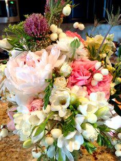 Bridal Bouquet with garden roses, peonies, larkspur, hypernicum berries, gardenias, and thistle.