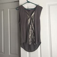 Classy top This fun gray top is perfect for a night out. It is laced down each side with an abundance of sequences. Never worn and in perfect condition American Eagle Outfitters Tops Tank Tops