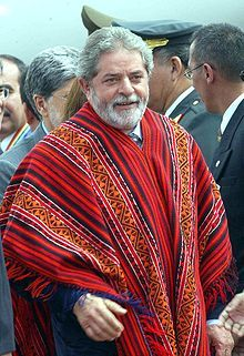 The poncho, which is a rectangular piece of cloth with a slit for the head, originated in South America and is considered to be the inspiration for cloaks and capes worn in the Victorian Era.