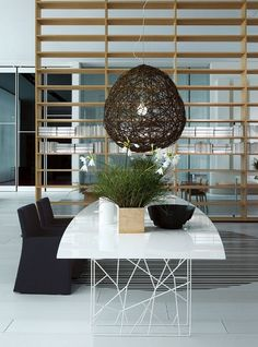 Although this is a lot too stark & minimalist for my taste, what I do like are how the random openness of the table legs are reiterated in the large pendant shade and, to a lesser extent, by the room divider.