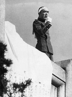 "Mishima Yukio (1925-1970) Addressing Japanese Military  On November 25, 1970, Mishima Yukio and his followers arrive at the Ichigaya Headquarters of the Japanese Eastern Army to read his ""Manifesto"", trying to rouse the 2000 soldiers to take action and save Japan: ""Japan's present politics are full of corruption"", Mishima said, closing his speech with the war cry of old Japanese armed forces, ""Tenno Banzai"" (Long Live His Majesty the Emperor). Mishima then commits ""seppuku"" (ritual…"