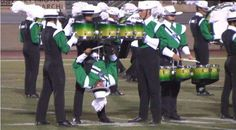"""Upside-down tenor drummers, a highlight from The Cavaliers' (Rosemont, IL) 2011 DCI show, """"XtraordinarY""""..."""