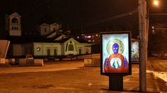 """Russian Street Artist Accused Of Blasphemy For Replacing Ads With Pussy Riot """"Icons"""""""