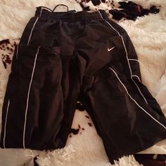 Nike sweatpants Few years old some tears on the bottom. I believe they're mens. Nike Pants Track Pants & Joggers