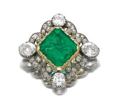 126 EMERALD AND DIAMOND BROOCH SECOND HALF OF 19TH CENTURY AND LATERSet with cushion-shaped oval and circular-cut diamonds later set to thecentre with a step-cut emerald later brooch fitting.
