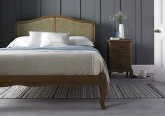 The Loire rattan low foot end bed is a beautiful French inspired frame which combines the beauty of weathered oak, with a rattan headboard to create a design that is elegant and sophisticated. Each frame is carefully crafted with subtle hand carved detailing that gives the bed a luxurious and opulent feel. Classically styled, the bed will work equally well in either a traditional or more contemporary interior. The :Loire features a traditional wooden slatted base system which helps to sup...