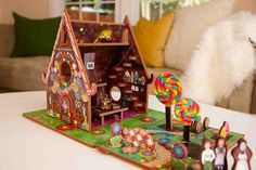 The sweetest dollhouse ever. Based on the Hansel and Gretel fairytale, this gingerbread house features peppermint sticks, gum drops, lollipops and lots and lots of chocolate in its design. Inside is the witch's kitchen were the tale unfolds. Perfect for 3 and 4 year olds and older! Storytime Toys Hansel and Gretel dollhouse and storybook playset.