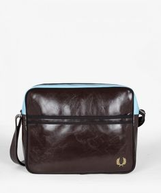 One of the most recognisable pieces of 1960s Mod uniform was the square PVC shoulder bag, a style that went hand in hand with scooter culture. This compact and functional bag has an adjustable strap, with a slip pocket and our trademark tipping across the