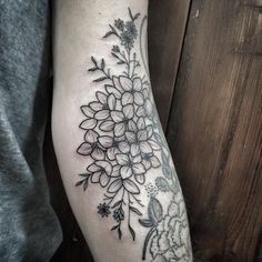 """a pleasure adding a hydrangea on Emily. existing flowers done by another tattooer."""