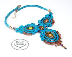 """Necklace made with soutache embroidery technique. Purple agate, chrysocolla, zirconia chain gold / purple and fire polish surrounded on green and purple braid cord. Backside is made of green natural leather. Metallic finish in silver color. Impregnated which significantly reduces the absorption of dirt. Soutache motif has height 12 cm (4,75""""). Circumference around the neck 45 cm (17,75"""") plus 5 cm chain."""