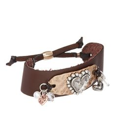A hammered plate and leather strap support the artisan-inspired design of this bracelet featuring a heart and dainty beads.