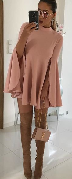 #spring #outfits woman wearing pink bell-sleeved dress and pair of brown thigh-high boots. Pic by @women_fashion.blog