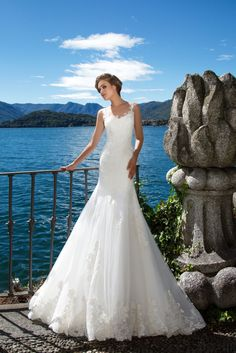 Doriana - White Desire - MillaNova Exquisite mermaid wedding gown Doriana emphasizes your beauty and makes you irresistible. Totally lace decorated dress with delicate lace straps and mid-long trail fancied by hand with classy lace and falling from hips to the floor.