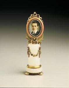 Frame with Miniature of Prince Nikolai Iusupov, Fabergé (firm) (frame); Aarne, Johann Viktor (workmaster) RUSSIA: Saint Petersburg 1896-1903 Gold, enamel, diamonds, rubies, white agate, mother of pearl, ivory