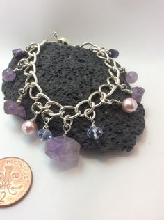A personal favourite from my Etsy shop https://www.etsy.com/uk/listing/465105931/gemstone-charm-bracelet