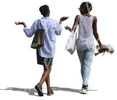 Two black women walking and talking