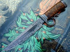 Custom handmade Damascus steel hunting knife with stunning clip