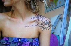 Flower outline tattoo on the shoulder.... in freaking love