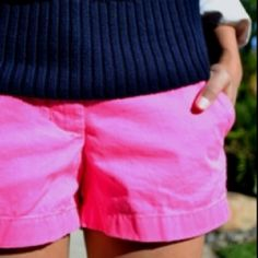 bright pink shorts & navy sweater.
