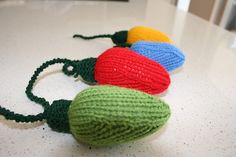 http://www.ravelry.com/patterns/library/4-christmas-knitting-patterns---baubles-gift-lights-and-crackers - Pattern is $6.25