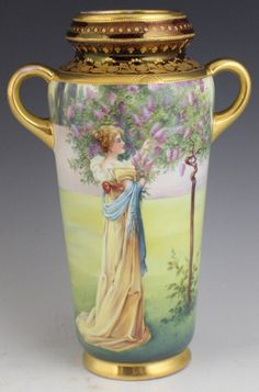 ROYAL VIENNA HAND PAINTED PORCELAIN VASE WITH GILDED ENAMEL. PICTURE  FEATURES A WOMAN PICKING LILACS. EARLY 20TH CENTURY | JV