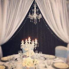 Gorgeous French provincial table setting and white chandelier backdrop