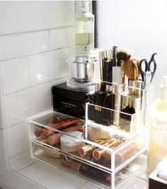 love those clear #muji organizing compartments. what a great way to store makeup!