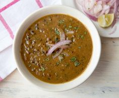 The Dal Makhani Recipe is a deliciously flavoured lentil curry that is also popularly known as the Punjabi 'dhaba' dal. This dal makhani is made with black whole urad dal and rajma, flavoured with subtle Indian spices and simmered with cream and butter. Indian Food Recipes, Vegetarian Recipes, Cooking Recipes, Ethnic Recipes, Makhani Recipes, Paneer Recipes, Dal Recipe, Masala Recipe, Using A Pressure Cooker