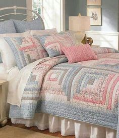 Would use different colors, but this quilt demos that you don't need high contrast in color to make a beautiful log cabin quilt ...
