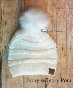 f150448bee5ca5 A little twist on the popular CC beanie hats - a faux fur pom pom on top!  Available in 20 fabulous colors - the perfect winter accessory!