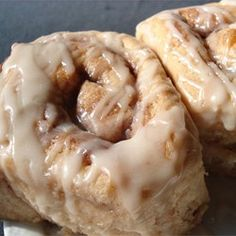 White cake mix is the magic ingredient in these rich cinnamon yeast rolls peppered with pecans on top.