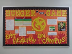 Resident Assistant Bulletin Board for Healthy Eating On Campus Hunger Games themed! RA