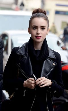 Her fashion style is absolutely perfect. Notice the jacket, purse, nails, make-up, hair, even cell phone case.  I even love the simple small gold earrings. #fashion #street style #black